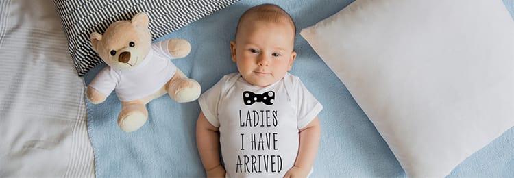 Baby with custom baby grow and matching teddy bear
