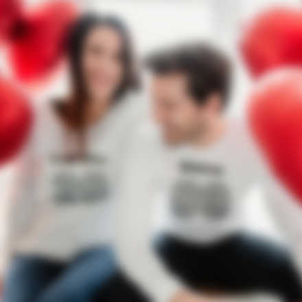 Couple wearing custom longsleeves with Valentine\'s Day design