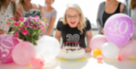 Girl blowing out birthday candles in customizable birthday T-shirt