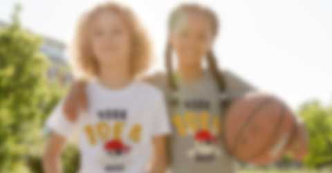 Young boy and young girl posing with basketball in custom t-shirts