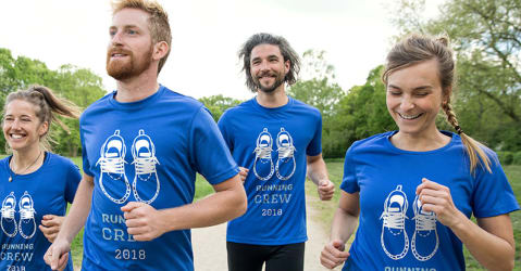 A group of runners train in personalized T-shirts that can be customized for the whole team.