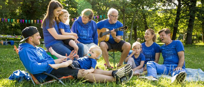 Men, women, and kids wearing customizable shirts at family reunion