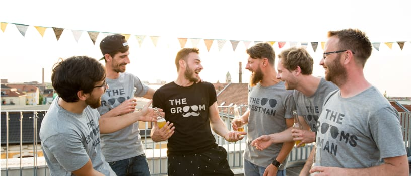 Friends enjoying bachelor party in customizable t-shirts