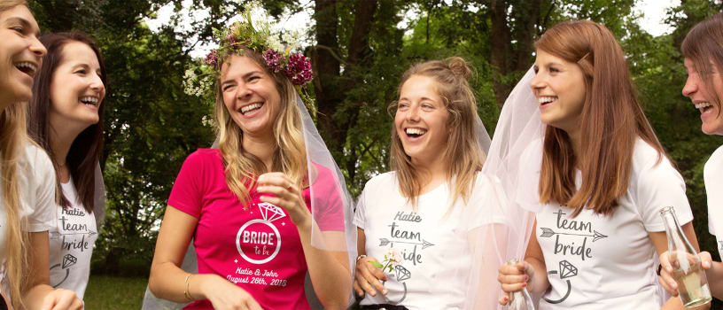 Friends enjoying bachelorette party in customizable t-shirts