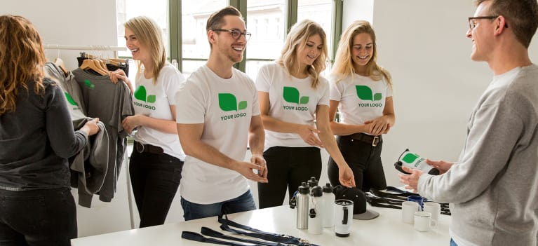 Employees enjoying work in customizable shirts