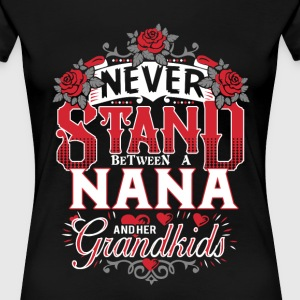 Nana - Never stand between her and her grandkids - Women's Premium T-Shirt