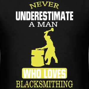 NEVER UNDERESTIMATE A MAN WHO LOVES A BLACKSMITH! T-Shirts - Men's T-Shirt