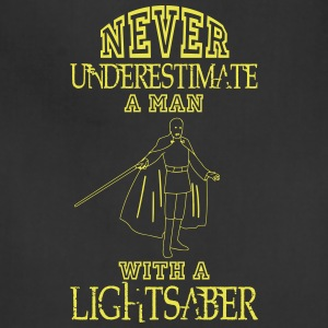NEVER UNDERESTIMATE A MAN WITH A LIGHTSABER! Aprons - Adjustable Apron