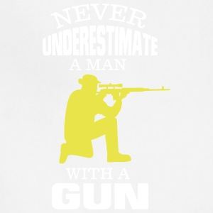 NEVER UNDERESTIMATE A MAN WITH A GUN! Aprons - Adjustable Apron