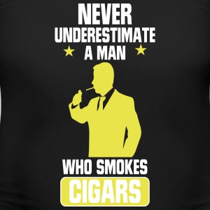 NEVER UNDERESTIMATES A MAN WHO SMOKES CIGARS! T-Shirts - Women's Maternity T-Shirt