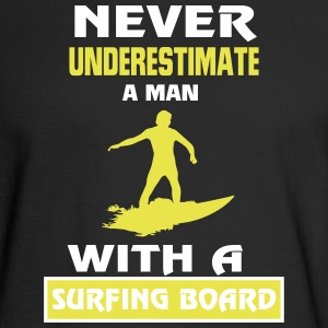 NEVER UNDERESTIMATE A MAN WITH A SURFING BOARD! Long Sleeve Shirts - Men's Long Sleeve T-Shirt