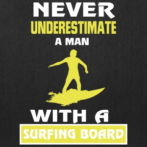 NEVER UNDERESTIMATE A MAN WITH A SURFING BOARD! Bags & backpacks - Tote Bag