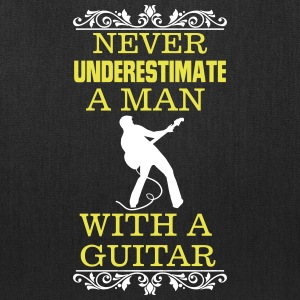 NEVER UNDERESTIMATE A MAN WITH A GUITAR Bags & backpacks - Tote Bag