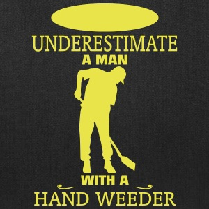 NEVER UNDERESTIMATE A MAN WITH A HAND WEEDER! Bags & backpacks - Tote Bag