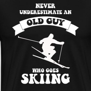 Never underestimate an old guy who loves skiing - Men's Premium T-Shirt