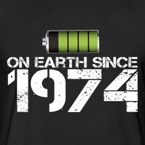 on earth since 1974 - Fitted Cotton/Poly T-Shirt by Next Level