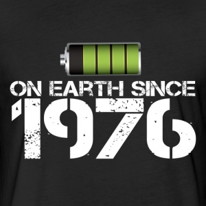 on earth since 1976 - Fitted Cotton/Poly T-Shirt by Next Level