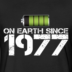on earth since 1977 - Fitted Cotton/Poly T-Shirt by Next Level