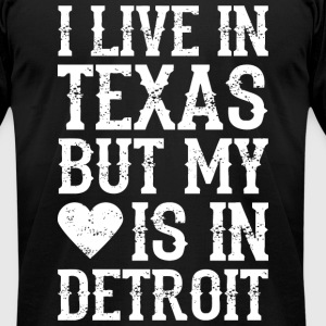 I LIVE IN TEXAS BUT MY HEART IS IN DETROIT T-Shirts - Men's T-Shirt by American Apparel