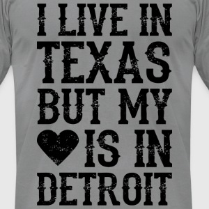 I LIVE IN TEXAS BUT MY HEART IS IN DETROIT_black T-Shirts - Men's T-Shirt by American Apparel