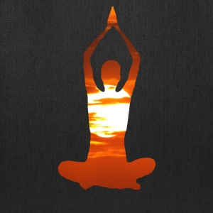 Man meditating yoga in the evening sun 02 Bags & backpacks - Tote Bag