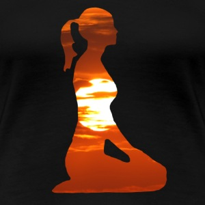 Yoga woman meditating in the evening sun Women's T-Shirts - Women's Premium T-Shirt