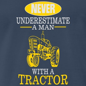 NEVER UNDERESTIMATE A MAN WITH A TRACTOR! Sportswear - Men's Premium T-Shirt