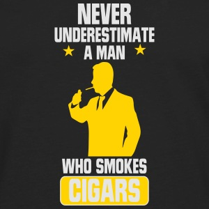 NEVER UNDERESTIMATES A MAN WHO SMOKES CIGARS! Caps - Men's Premium Long Sleeve T-Shirt