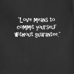 Love means to commit yourself without guarantee. T-Shirts - Adjustable Apron