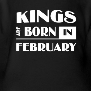Kings are born in February - Short Sleeve Baby Bodysuit