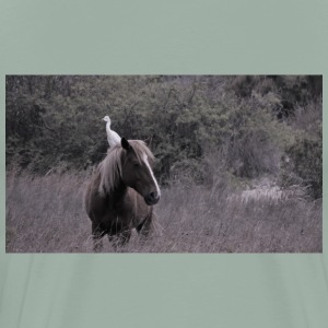 A bird riding on a back of a wild horse on Duck Is - Men's Premium T-Shirt
