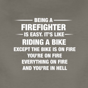 Being A Firefighter Is Easy It's Like Riding - Women's Premium T-Shirt
