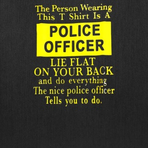 The Person Wearing This Shirt Is A Police Officer - Tote Bag