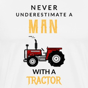 Never underestimate a man with his tractor! - Men's Premium T-Shirt