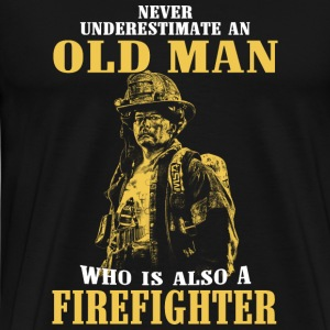 Firefighter - never underestimate a - Men's Premium T-Shirt