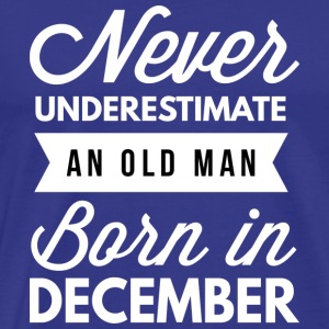 Never underestimate an old man born in December - Men's Premium T-Shirt