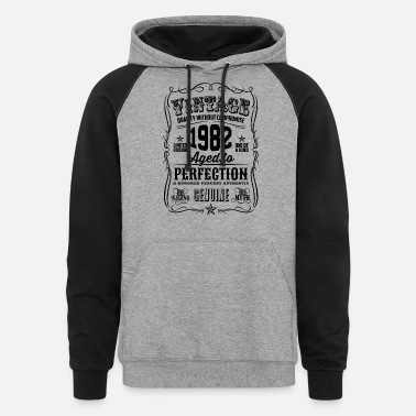 Vintage 1982 Aged to Perfection Black Print - Unisex Colorblock Hoodie