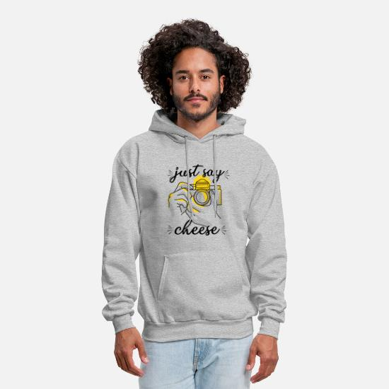 Holding Hoodies & Sweatshirts - Holding camera dslr shoot - Men's Hoodie heather gray