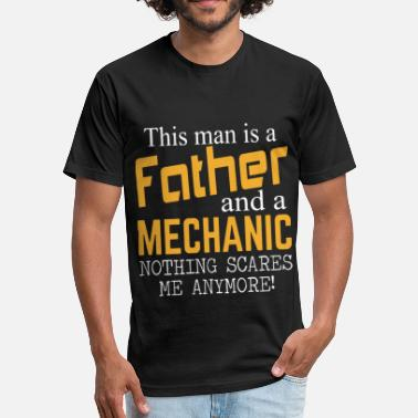 This man is a father and a mechanic nothing scares - Fitted Cotton/Poly T-Shirt by Next Level
