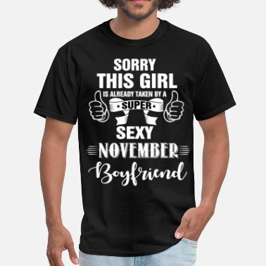 November Boyfriend sorry this girl is already taken by a super sexy  - Men's T-Shirt