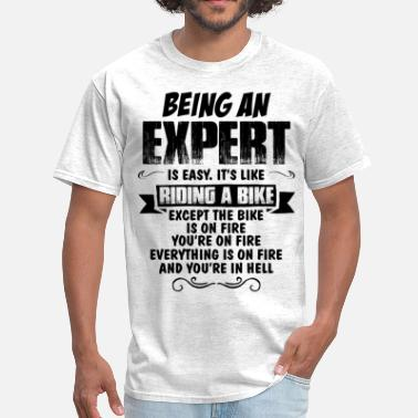 Being An Artist Is Easy Its Like Riding A Bike Except The Bike Is On Fire Being An Expert... - Men's T-Shirt