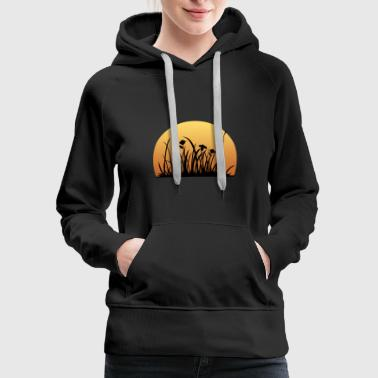 Sunset behind the meadow with the flowers - Women's Premium Hoodie