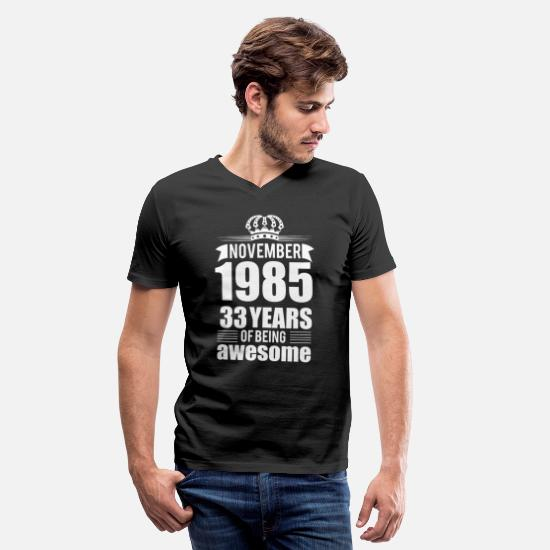 Born T-Shirts - November 1985 33 Years Of Being Awesome Years - Men's V-Neck T-Shirt black