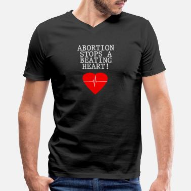 Anti-abortion Abortion stops a beating Heart - Anti-abortionist - Men's V-Neck T-Shirt by Canvas