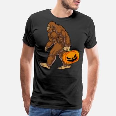 Undefeated Bigfoot Sasquatch Carrying Scary Pumpkin T shirt - Men's Premium T-Shirt