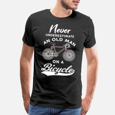 Never underestimate an old man on a bicycle - Men's Premium T-Shirt