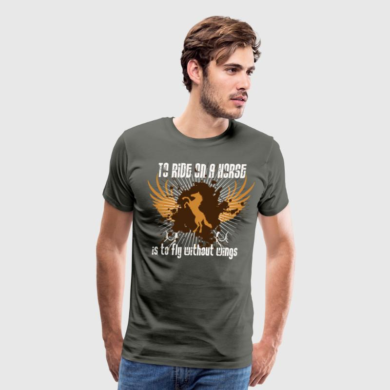 To ride on a horse is to fly without wings - Men's Premium T-Shirt