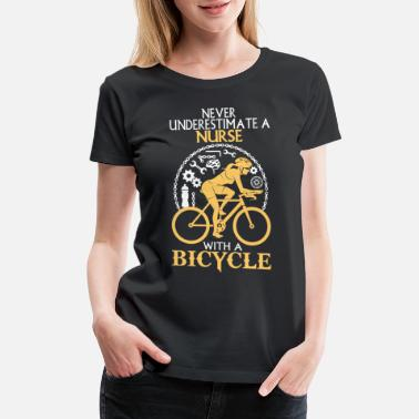 Bicyclette Nurse with a bicycle - Never underestimate - Women's Premium T-Shirt