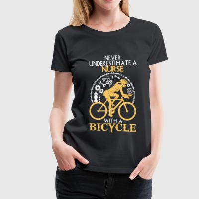 Nurse with a bicycle - Never underestimate - Women's Premium T-Shirt