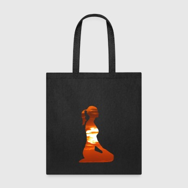 Yoga woman meditating in the evening sun - Tote Bag